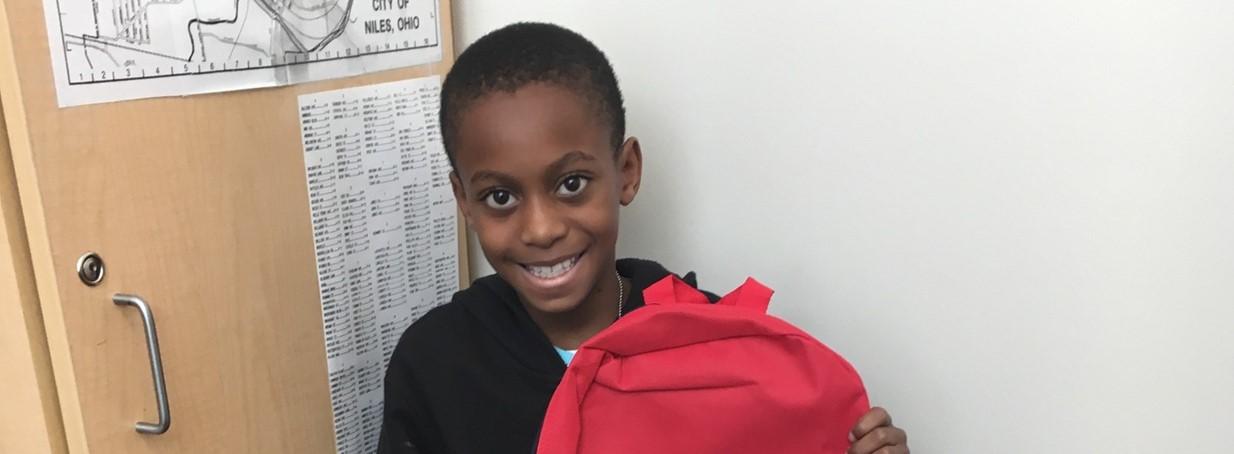 Student receives new bookbag