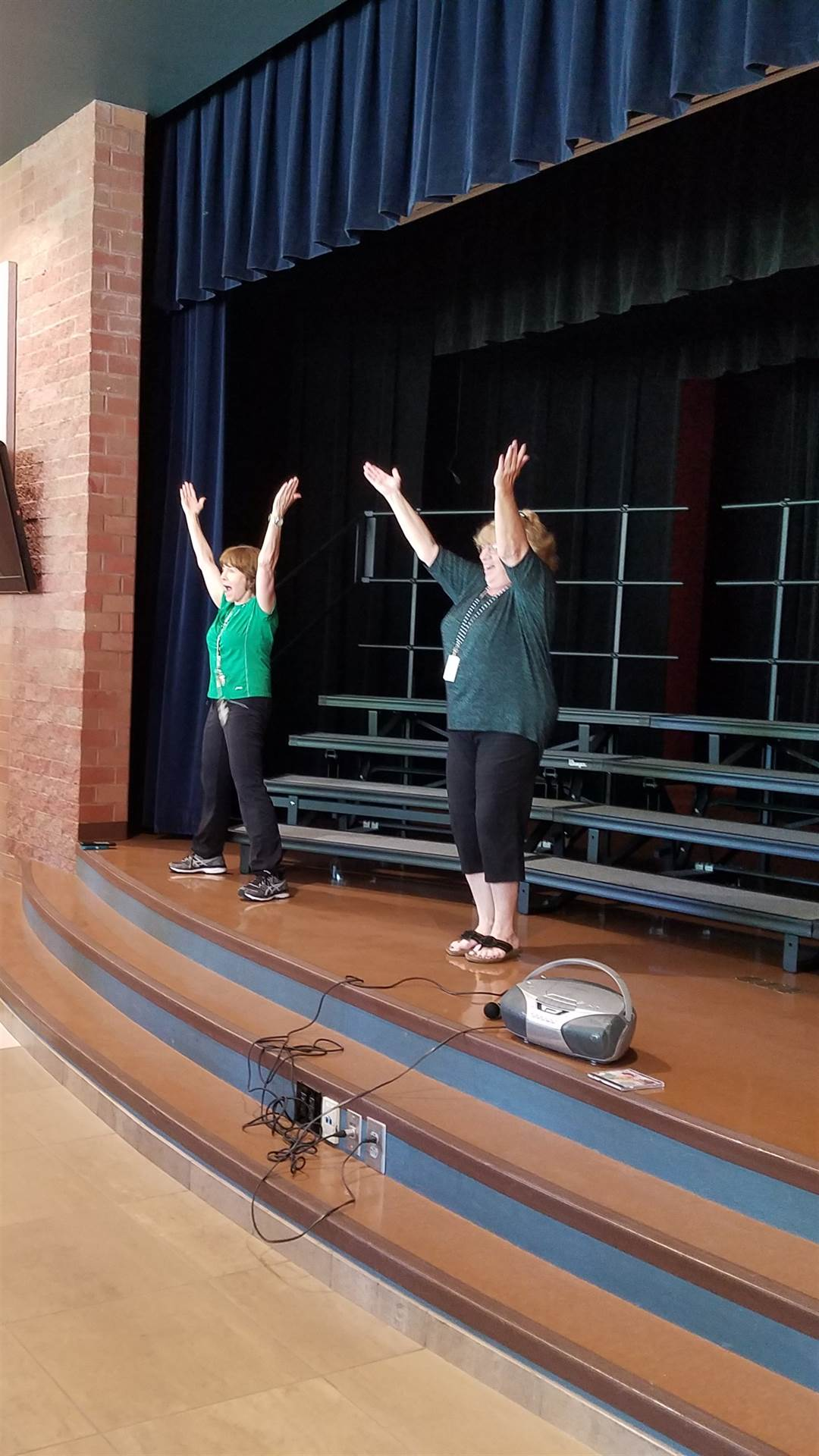 """Fun at lunch! Mrs. Tominey and Mrs. Megert lead the 4th grade students in dancing to the """"YMCA&"""
