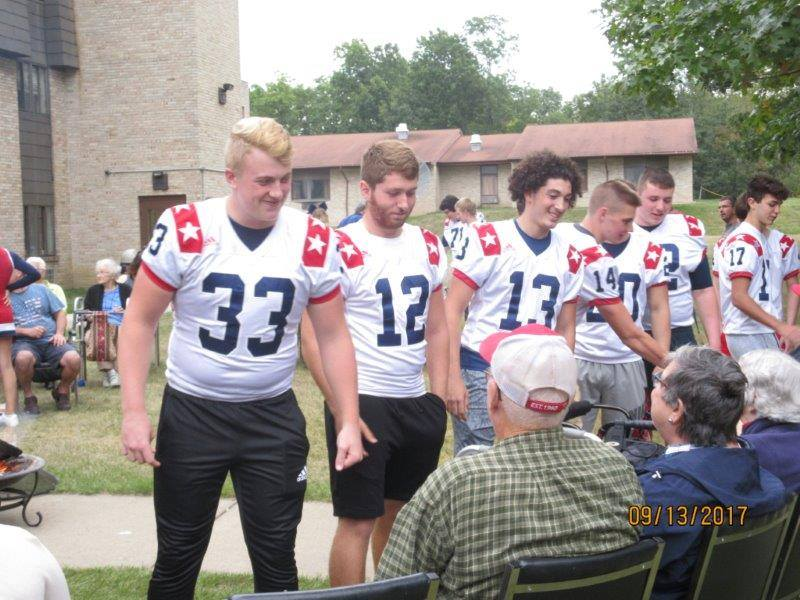 Football team visits Shepard of the Valley