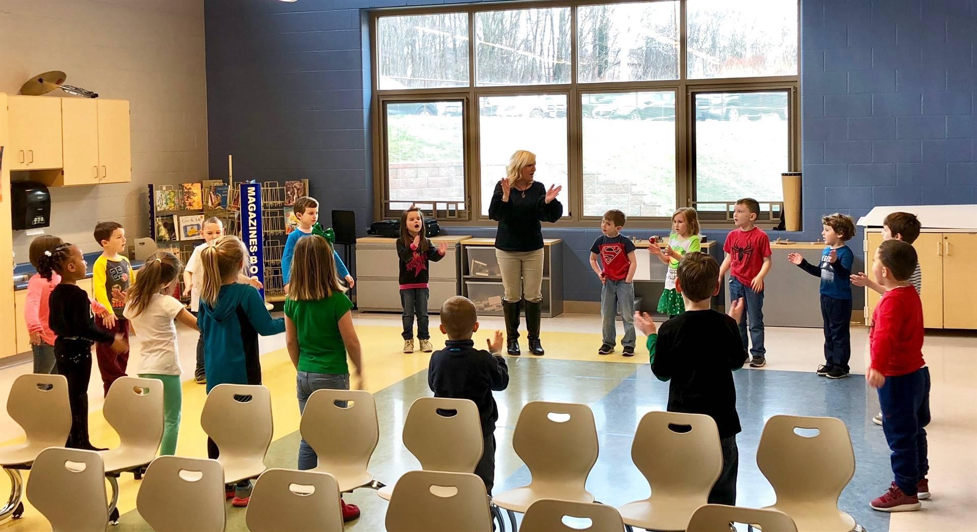 Mrs. Mattern teaching music to Mrs. Tricomi's kindergarten class