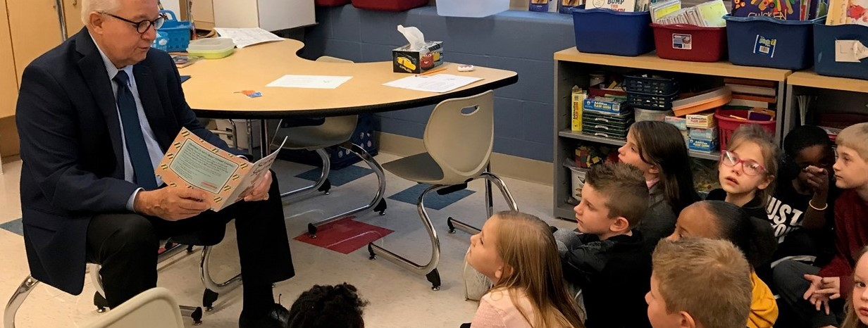 Community members read to students at Niles Primary School.