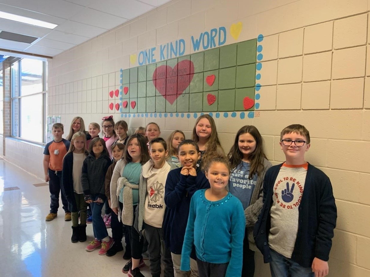Niles Intermediate students in front of the Kindness Wall