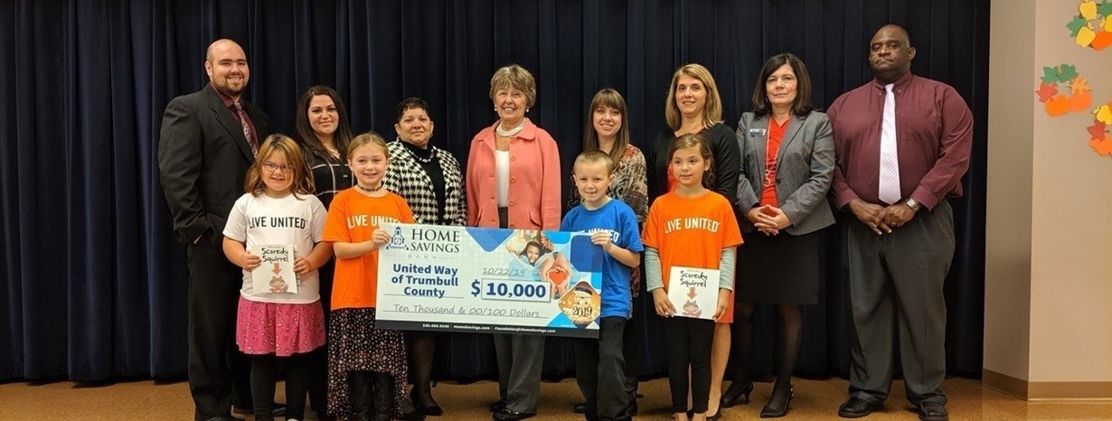 Niles Primary School accepts 10 thousand dollar check.