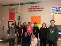 Students pose with their palm oil research posters.